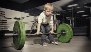 Boy weight lifter